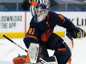 Oilers goaltender Mike Smith (41) faces the Jets in Game 2 of their NHL North Division playoff series at Rogers Place in Edmonton, May 21, 2021.