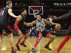 Raptors rookie Scottie Barnes controls the ball during a team scrimmage in London, Ont., on Saturday.