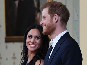 Britain's Prince Harry and Meghan, Duchess of Sussex attend a reception at Government House in Melbourne on October 18, 2018.