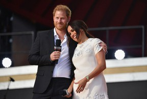 Britain's Prince Harry and Meghan Markle speak during the 2021 Global Citizen Live festival at the Great Lawn, Central Park on September 25, 2021 in New York City.