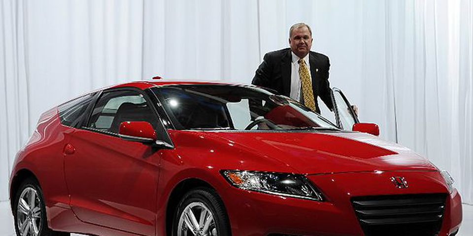 John Mendel, Executive Vice President, American Honda Motor Co., Inc. poses with the Honda CRZ during the first press preview day at the 2010 North American International Auto Show January 11, 2010 at Cobo Center in Detroit, Michigan.