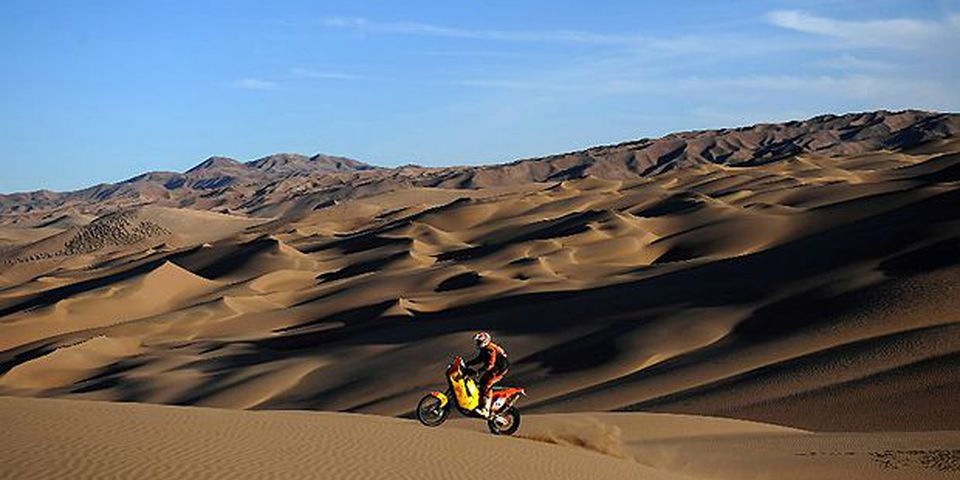 France's Alain Duclos rides his KTM during the 7th stage of the Dakar 2010, between Iquique and Antofagasta, Chile, on January 8, 2010. France's Cyril Despres won the stage and leads the race, Spain's Marc Coma took the second place and France's David Fretigne the third.