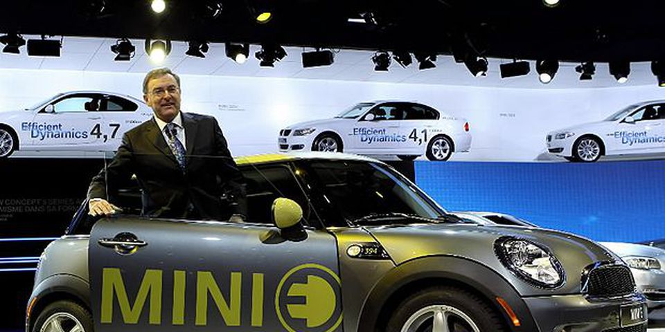 BMW Chairman and CEO Norbert Reithofer presents an electric Mini car during the first press day at the 80th Geneva International Motor Show on March 2, 2010 in Geneva, Switzerland. The show features World and European premieres of cars and will be open to the public March 4 to 14, 2010.