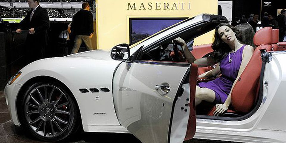 A model poses sitting in the new Maserati GranCabrio on March 3, 2010 during the third press day at the 80th Geneva International Motor Show at Palexpo in Geneva.