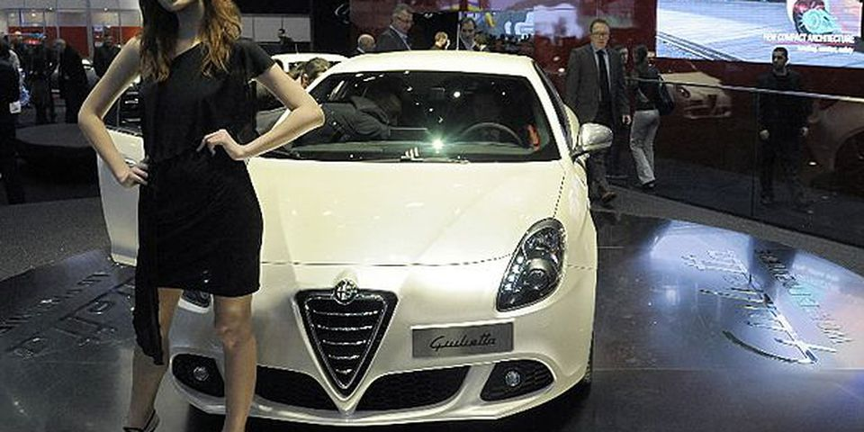 A model poses in front of the new Giulietta by the Italian carmaker Alfa romeo on March 3, 2010 during the third press day at the 80th Geneva International Motor Show at Palexpo in Geneva, Switzerland.