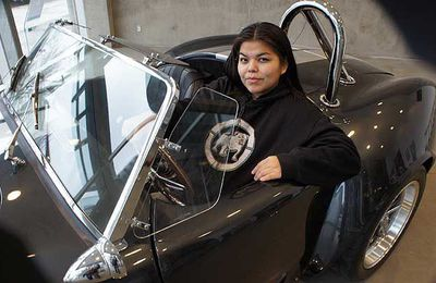 Chloe Brown sits in the 500-horsepower Cobra built at Vancouver Community College in the NASKARZ (Never Again Steal Cars) program.