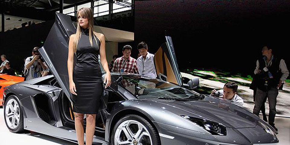 A model stands beside the Lamborghini Aventador LP700-4 sport car during the media day of the Shanghai International Automobile Industry Exhibition at Shanghai New International Expo Center on April 19, 2011 in Shanghai, China.