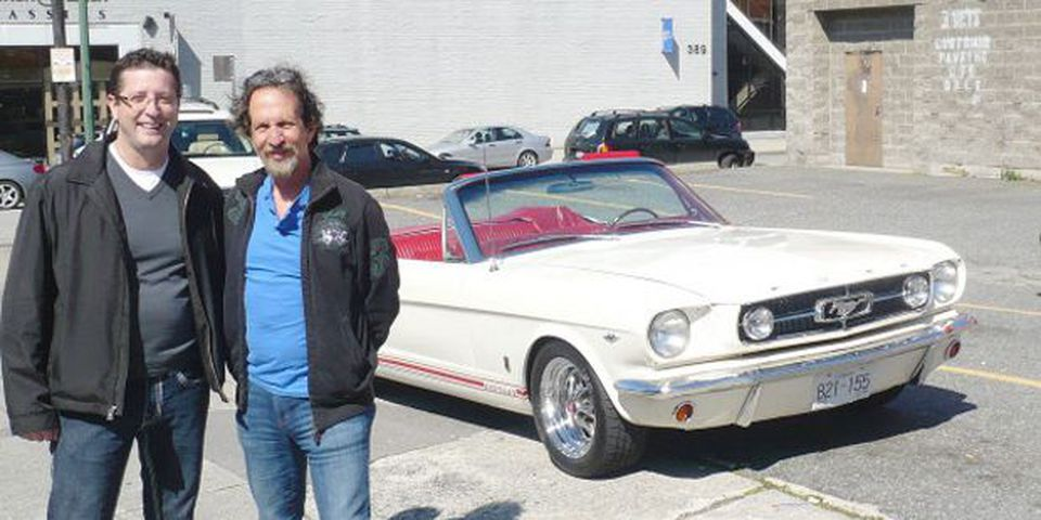 1965 Mustang convertible with owner Herb Johnstone (left) and 3 Vets store owner Jerry Wolfman, whose parents won the car in 1965.