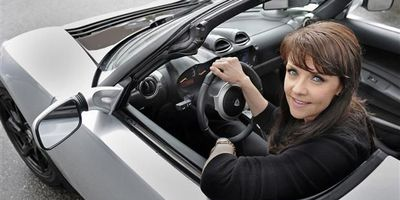 Stargate actress Amanda Tapping tests out a 2011 Tesla Roadster for Big Wheels.