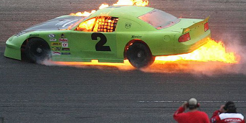 The Dodge Charger driven by Greg Ratzlaff of Wetaskiwin catches fire in the early laps of the Border Challenge 150 race on the half mile oval at Race City. He escaped from the inferno unharmed.