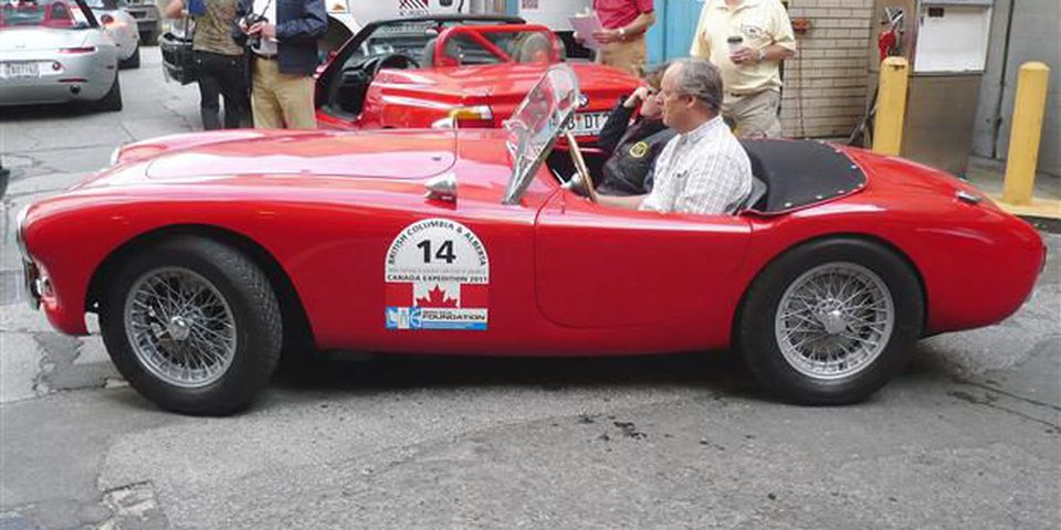 Peter and Zoe Lovett drive away from the Hotel Vancouver in their BMW-powered 1960 AC Bristol.