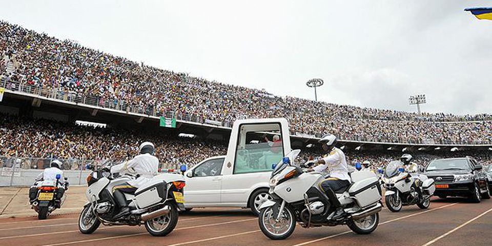 Pope Benedict XVI salutes the crowd from his popemobile in the Amadou Ahidjo stadium in Yaounde on March 19, 2009, the third day of his 6-day visit to Africa.