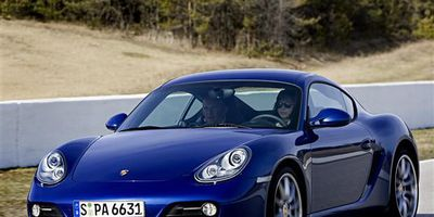 Jodi Lai drives a Porsche Cayman S with instructor Stef Vancampenhoudt at Mosport International Raceway in Bowmanville, Ontario.