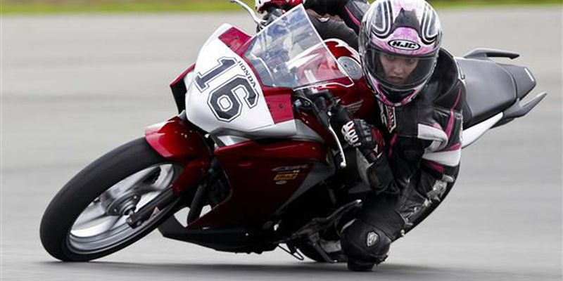 Stacey Nesbitt tackles a corner on her motorcycle.