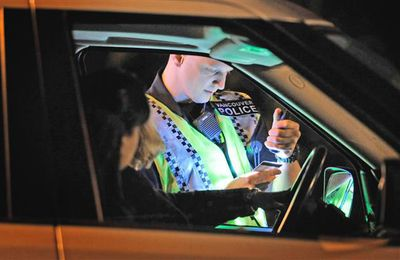 Police officers conduct a roadblock checking for impaired drivers in this file photo.