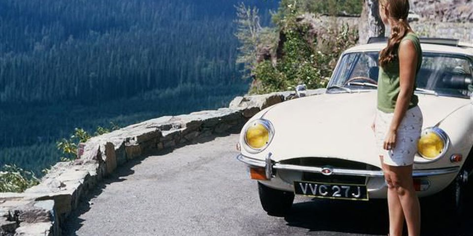Jackie Wainwright with the new 1970 Jaguar XKE coupe on an extended honeymoon with husband Michael in Europe.