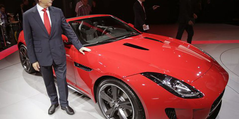 Dr. Ralf D. Speth, Chief Executive Officer of Jaguar LandRover Limited, poses next to a new Jaguar F-Type during the press day at the Paris Auto Show.