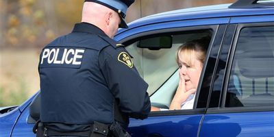 A woman in Windsor is pulled over by police for using a cellphone while driving in this file photo.