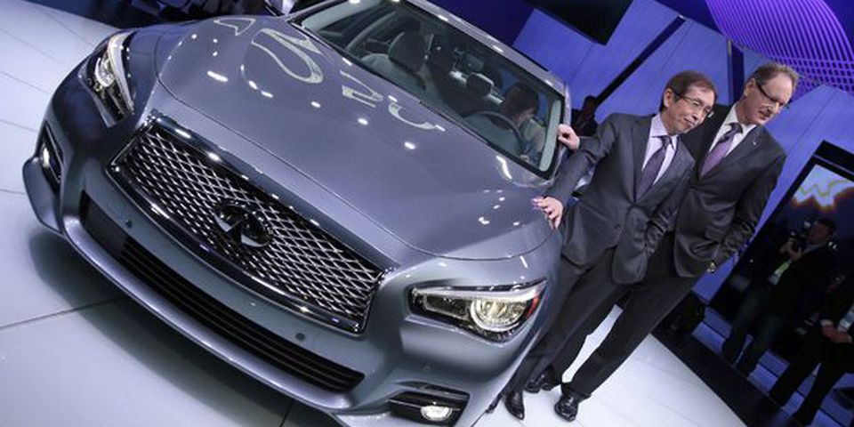 Shiro Nakamura (L), Chief Executive Officer for Infiniti, and Johan Nysschen, President of Infiniti, pose with the new Infiniti Q50 luxury sports car at the 2013 North American International Auto Show in Detroit.