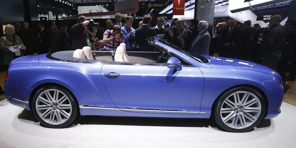 Bentley Chairman and CEO Wolfgang Schreiber unveils the GT Speed Convertible during the North American International Auto Show in Detroit.