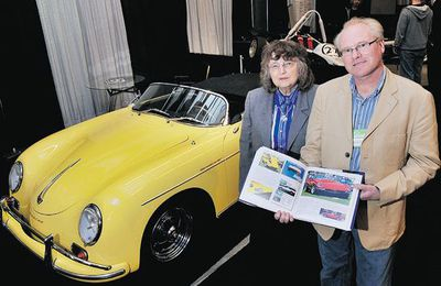 Paula Reisner of sports car builder Intermeccanica checks out the new book on the firm with author Andrew McCredie at the recent Vancouver International Auto Show.