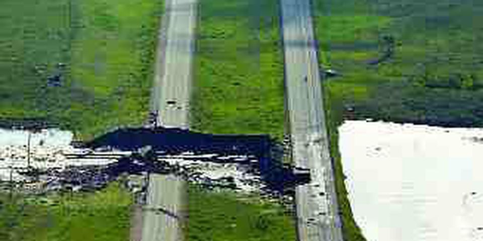 (Left) Water has washed out three of the four lanes of the Trans-Canada Highway near Maple Creek.