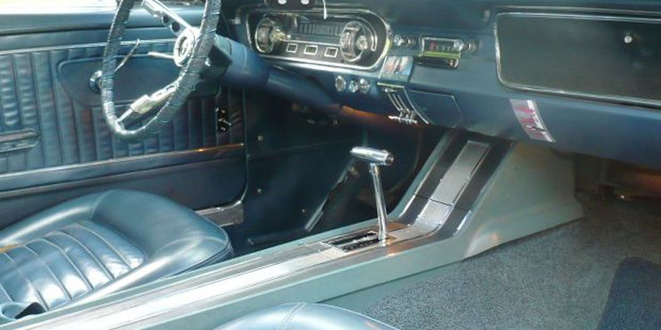 The matching blue interior of Pat Comey's 1965 Mustang 2+2 Fastback features bucket seats and a console-mounted floor shift for the automatic transmission.