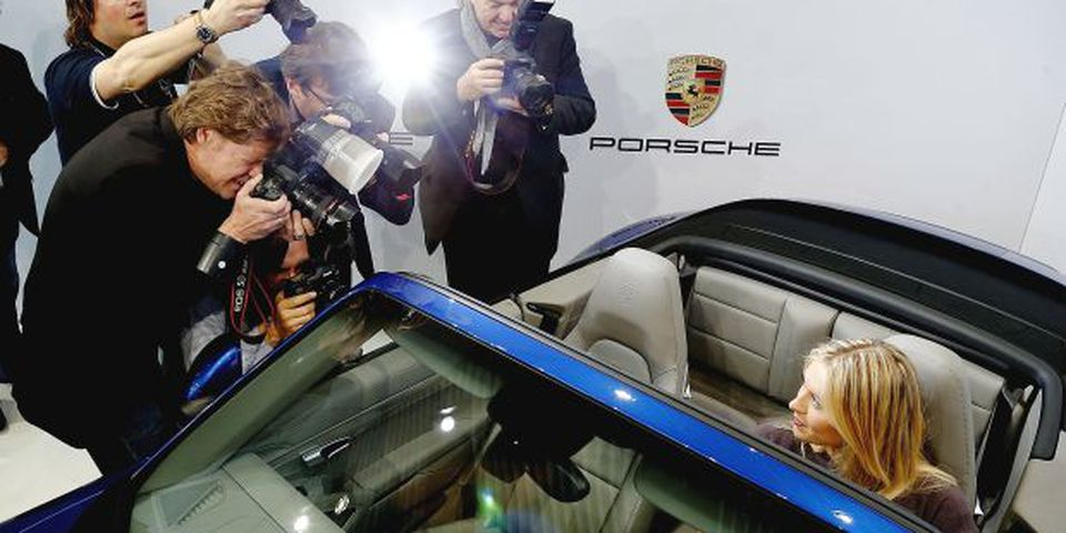 Tennis player Maria Sharapova poses for the media as she is unveiled as car manufacturer Porsche's new brand ambassador at the Porsche Museum on April 22, 2013 in Stuttgart, Germany.