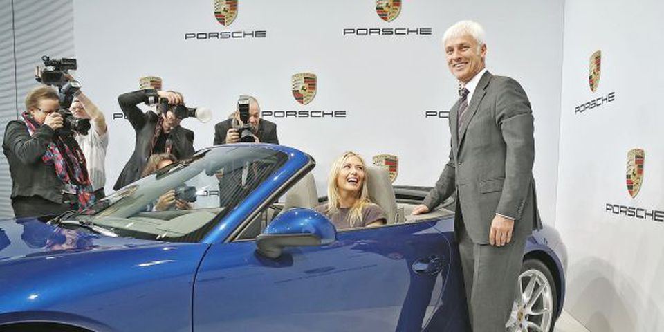 Tennis player Maria Sharapova poses with Matthias Mueller (R), CEO of Porsche AG, as she is unveiled as car manufacturer Porsche's new brand ambassador at the Porsche Museum on April 22, 2013 in Stuttgart, Germany.