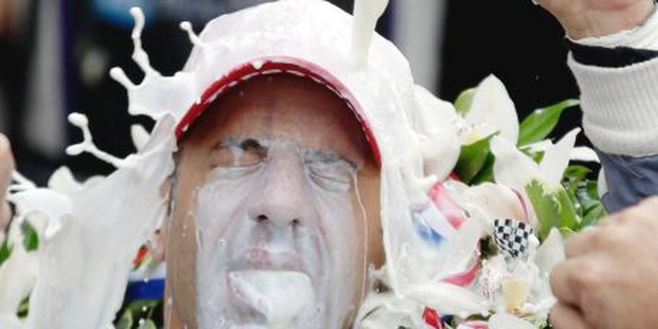Tony Kanaan, of Brazil, celebrates with winner's milk after winning the Indianapolis 500 auto race at the Indianapolis Motor Speedway in Indianapolis, Sunday, May 26, 2013.