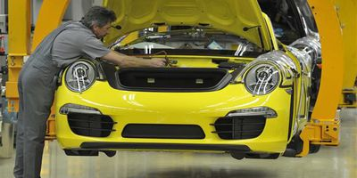 An employee of German luxury car maker Porsche working on the Porsche 911 sportcar assembly line at their plant in Stuttgart, southwestern Germany.
