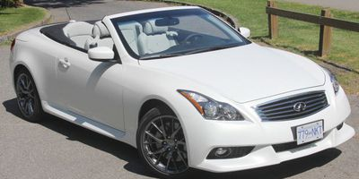 The Infiniti G37 IPL Convertible has a hard top that folds neatly behind the rear seat at the push of a switch. It's available in only two colours — white or black.   Bob Mchugh Photos/for the province  2013 Infiniti G37 IPL Conv. right front 3/4 view