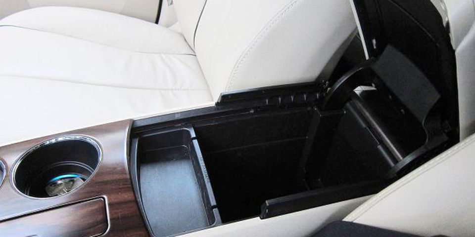 The well thought-out cabin features many cubbies and storage compartments, such as this deep bin beneath the cupholders.The cabin is well designed and features many cubbies and storage compartments, such as this deep bin beneath the cupholders.