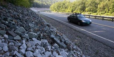 In this Aug. 22, 2013 photo, cars travel on the rebuilt Vermont Route 107 in Bethel, Vt. In what some consider a bit of an engineering marvel, a three-mile section of Route 107 between Bethel and Stockbridge, a major east-west highway that was destroyed by the storm, was rebuilt and reopened in 119 days, a job that normally would have taken two years. Driving in America has stalled, leading researchers to ask: Is the national love affair with the automobile over? After rising for decades, total