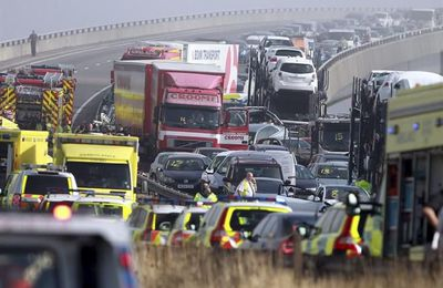 """Emergency vehicles attend the scene of a major accident on the Sheppey Bridge Crossing near Sheerness in Kent, south England, following a multi vehicle collision earlier this morning, Thursday Sept. 5, 2013. According to police at the scene around 100-vehicles are involved in the pile-up on a bridge in heavy fog, leaving at least eight people seriously injured after what witnesses described as ''carnage"""". (AP Photo/Gareth Fuller, PA) UNITED KINGDOM OUT - NO SALES - NO ARCHIVES"""