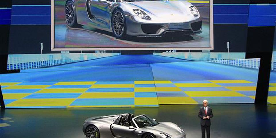Porsche AG CEO Matthias Mueller presents the new Porsche 918 Spyder during a preview by the Volkswagen Group prior to the 65th Frankfurt Auto Show in Frankfurt.