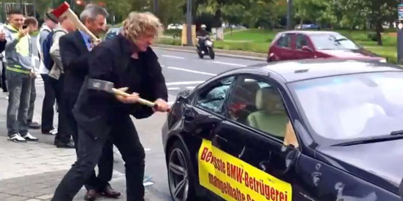 An angry BMW owner staged a dramatic protest by smashing up his M6 outside the Frankfurt Auto Show.