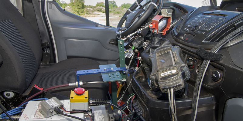 A robotic autonomous device inside a Ford Transit van at the automaker's proving grounds in Romeo, Mich.