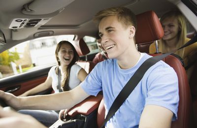 Smiling teenagers in a car
