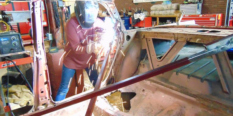 Sarah Wilkinson arc welding the body of her 1961 Pontiac