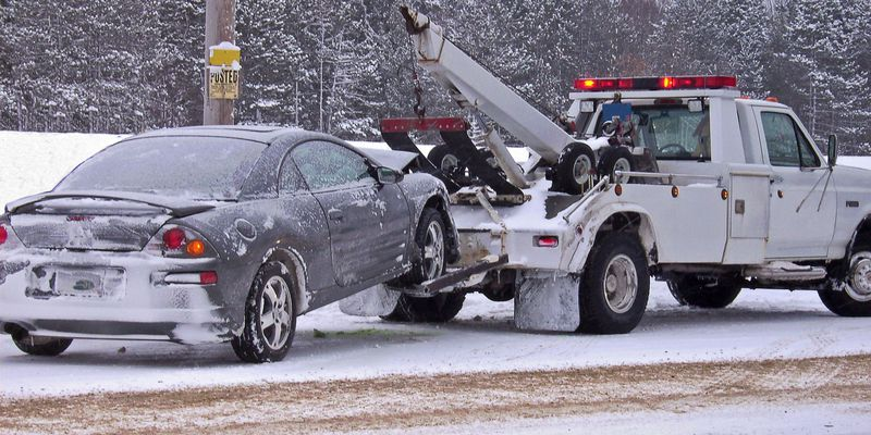 tow truck towing car