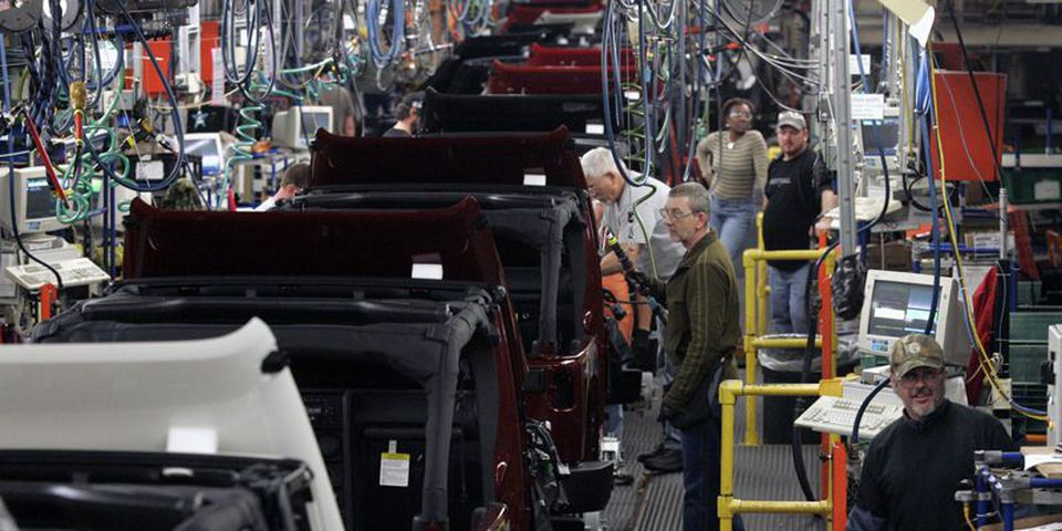 Chrysler assembly workers work on 2009 Jeep Wranglers at the Toledo Supplier Park Jeep plant in Toledo, Ohio.