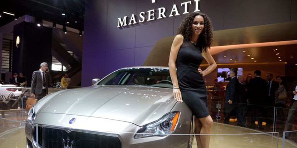 A model stands beside the Maserati Quattroporte Ermenegildo Zegna at the 2013 Frankfurt Motor Show.