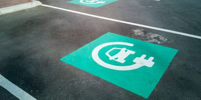 Electric car charging point parking with blue signs