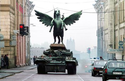 "A still from ""GoldenEye"" of a tank driving through a Russian city."