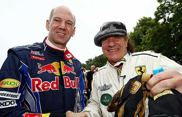 Adrian Newey, Red Bull Racing Chief Technical Officer shakes hands with Brian Johnson of the band AC / DC during day one of The Goodwood Festival of Speed at The Goodwood Estate on July 2, 2010 in Chichester, England.