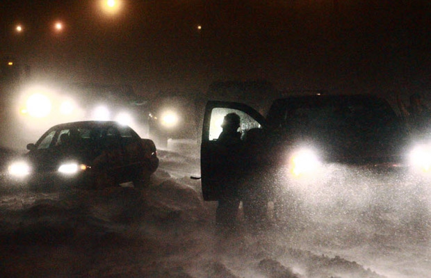 A car gets stuck in deep snow in Calgary in this file photo.