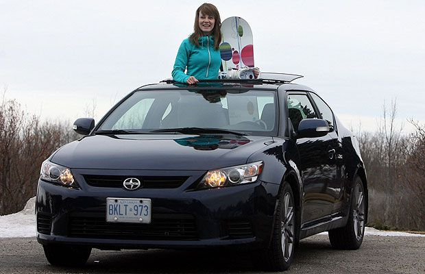 Sian Richards holds her board during her test drive of the new 2011 Scion tC.