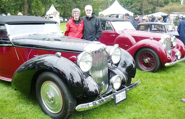 Liz Haan and Bill Holt at Vancouver's All British Field Meet with two of their three extremely rare British-built Lagonda V12 sports cars.