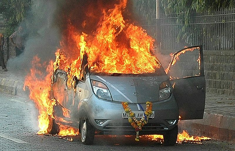 In this photograph taken on March 21, 2010, a brand new Tata Nano car, branded as the world's cheapest car, is seen engulfed in flames in the suburbs of Mumbai. India's leading vehicle maker Tata Motors offered free safety upgrades for the world's cheapest car, the Nano, on November 10, 2010 after several vehicles caught fire.